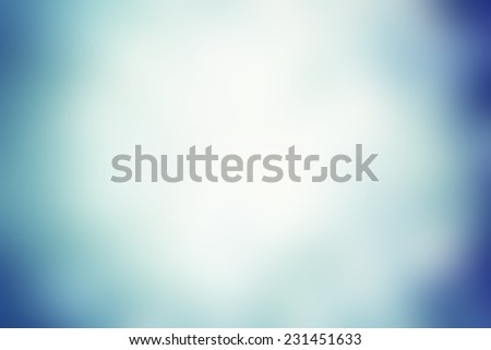Smooth blue Festive  background with white blurry lights. Christmas and New Year feast blur  background with copy space for your greeting text - stock photo