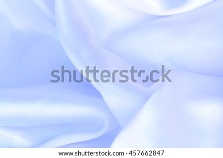 Smooth elegant blue silk, satin fabric background texture pattern - stock photo