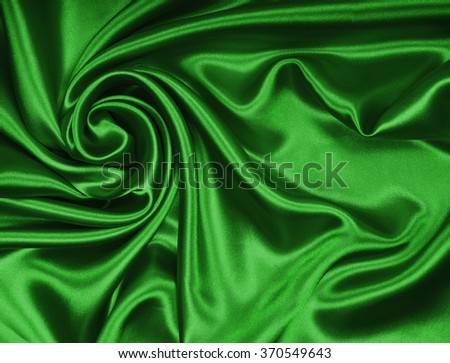 Smooth elegant green silk or satin texture can use as background - stock photo