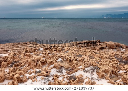 Smooth sea after sunset - stock photo