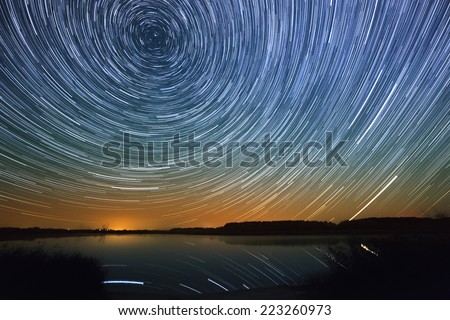 Smooth surface of the lake on a background the starry sky  - stock photo