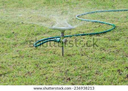 Smooth water drops from sprinkler - stock photo