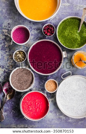 Smoothie bowls food collage smoothie chia bowl breakfast, acai yogurt bowl with super foods seeds on the side. overhead on grey stone surface with natural light .  - stock photo