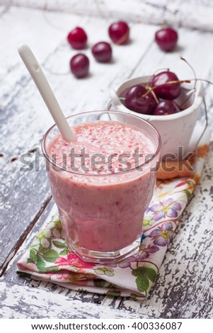 smoothie with cherry in a glass on a wooden background - stock photo