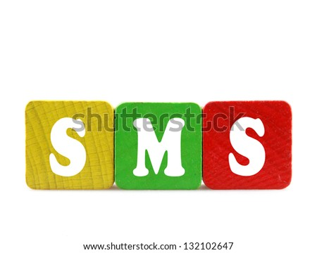 sms  - isolated text in wooden building blocks - stock photo