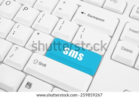 Sms keyboard button on white keyboard - stock photo