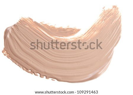 smudged liquid foundation isolated on white - stock photo