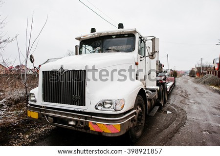 SMYKIVTSI, UKRAINE - MARCH 24, 2016: White Eagle truck at snowy weather - stock photo