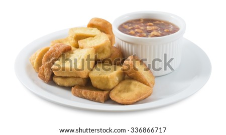 Snack and Dessert, Dish of Chinese Traditional Deep Fried Tofu or Fried Bean Curd Served with Sweet and Sour Spicy Sauce Isolated on White Background. - stock photo