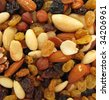 Snack food nuts and raisins - stock photo