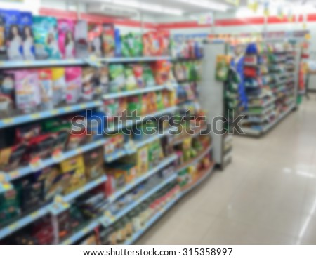 snack in shelf at supermarket on blur background - stock photo