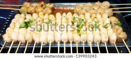 Snack on the street, taseful, delicious, spicy fish ball, pork ball, sausage  - stock photo