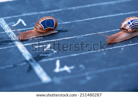 snails race metaphor about Europe against Greece - stock photo