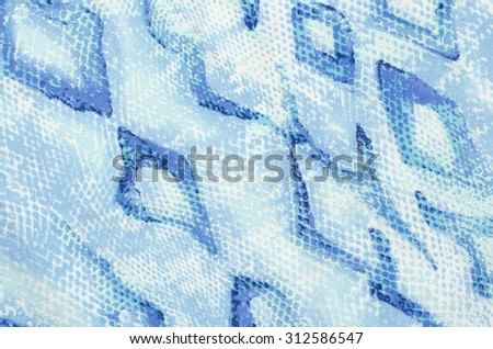 Snake skin pattern on fabric. Close up on blue snake skin print for background. - stock photo