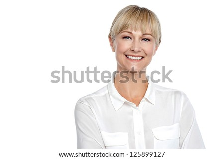 Snap shot of a cheerful confident business executive posing with a smile. - stock photo