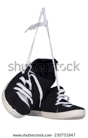 Sneakers athletic shoes black  laces white isolated background - stock photo