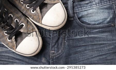 sneakers on jean pants - stock photo