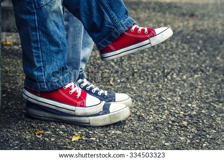 Sneakers on the child. Vintage shoes. - stock photo