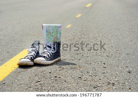 sneakers on the road. Path. Road. - stock photo