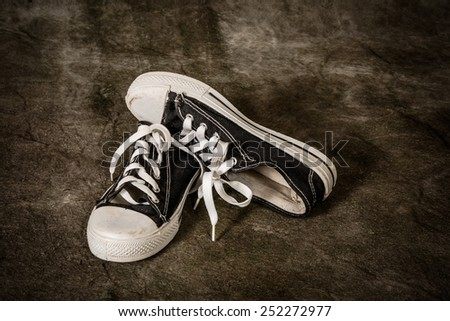 sneakers with grunge background - stock photo