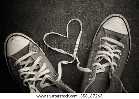 sneakers with heart with filter effect retro vintage style - stock photo