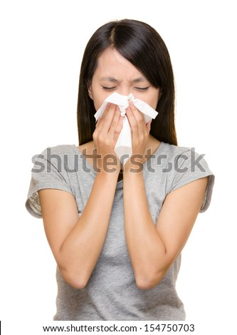 Sneezing asian woman - stock photo