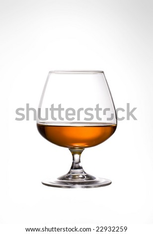 Snifter glass of cognac on white background. - stock photo