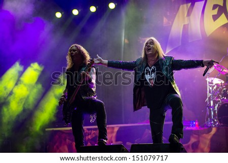 SNINA, SLOVAKIA - AUGUST 10: Markus Grosskopf and Andi Deris of the metal band Helloween perform on music festival Rock pod Kamenom in Snina, Slovakia on August 10, 2013 - stock photo