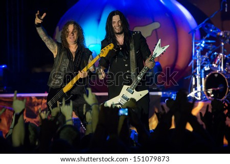 SNINA, SLOVAKIA - AUGUST 10: Markus Grosskopf and Sascha Gerstner of the german power metal band Helloween perform on music festival Rock pod Kamenom in Snina, Slovakia on August 10, 2013 - stock photo