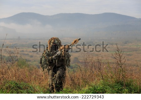 sniper comes from mission - stock photo