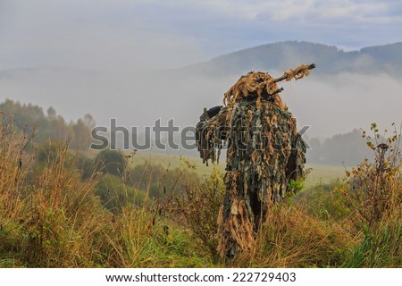 sniper leaves to fight for the line - stock photo