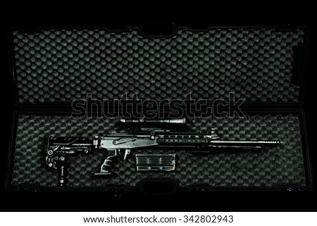 sniper rifle in a case on the dark background - stock photo