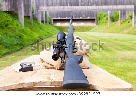 sniper rifle on gun range - stock photo