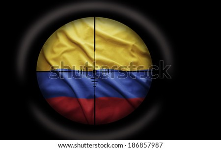 Sniper scope aimed at the Colombian flag - stock photo