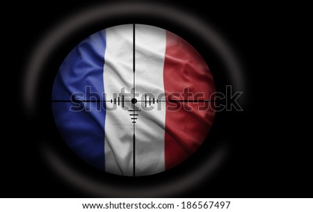 Sniper scope aimed at the French flag - stock photo