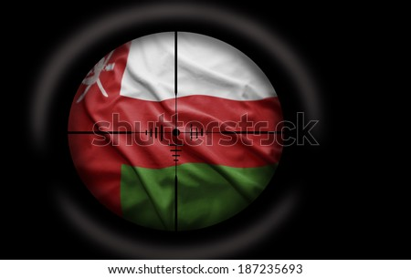 Sniper scope aimed at the Omani flag - stock photo