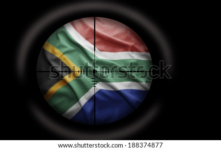 Sniper scope aimed at the South Africa flag - stock photo