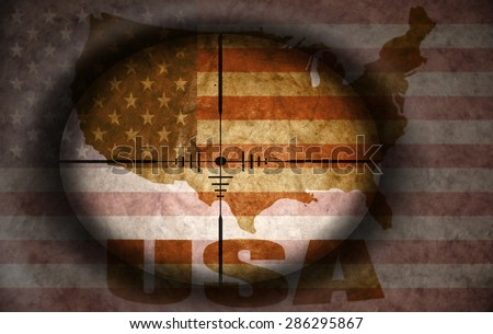 sniper scope aimed at the vintage american flag and map - stock photo