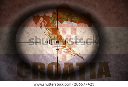 sniper scope aimed at the vintage  croatian flag and map - stock photo