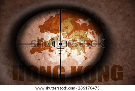 sniper scope aimed at the vintage hong kong flag and map - stock photo
