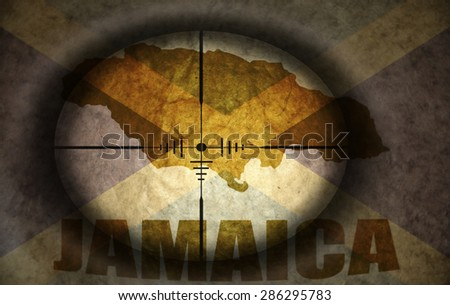 sniper scope aimed at the vintage jamaican flag and map - stock photo