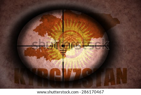sniper scope aimed at the vintage kyrgyzstan flag and map - stock photo