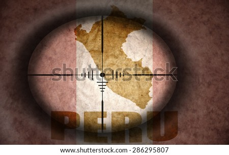 sniper scope aimed at the vintage peruvian flag and map - stock photo