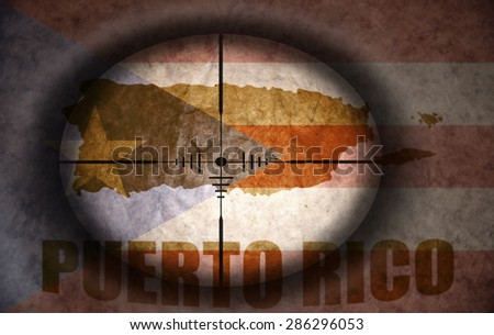 sniper scope aimed at the vintage puerto rico flag and map - stock photo