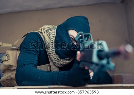 Sniper soldier in action. Concept about terrorism and war - stock photo