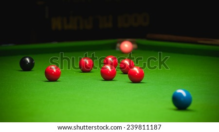 snooker ball on green surface table - stock photo