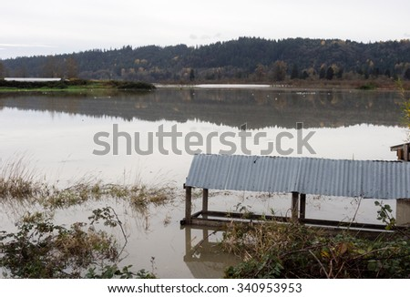 Snoqualmie river floods near the city of Duvall, WA - farmlands and roads under water - stock photo