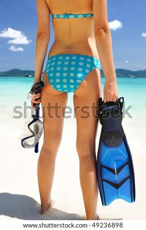 Snorkel woman at caribbean beach - stock photo