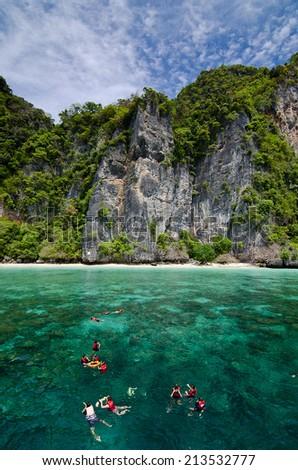 Snorkeling at Phi Phi Island, Phuket, THAILAND - stock photo