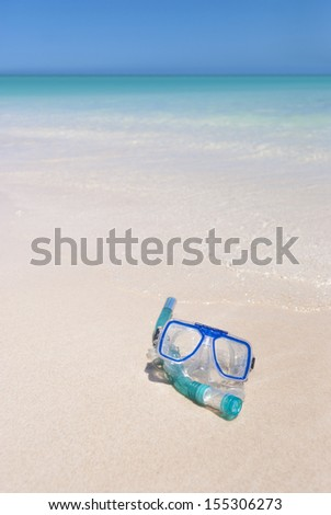 snorkeling gear on beach ready for your use. Just grab it and dive into a perfect paradise like water. Equipment and water have matching colors. Exmouth, Western Australia - stock photo